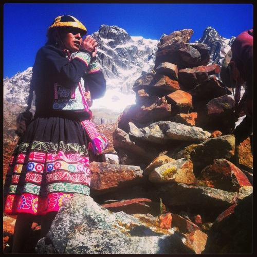Dona Berna praying at Umantay, holy mountain in the Andes